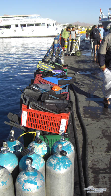 diving-gear-on-boat-jetty-450x798px.jpg